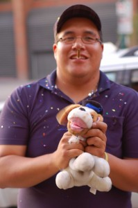 This guy caught the stuffed dog filled with glitter. Manly.