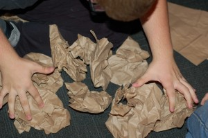 I think this kid eventually won but either way, here he is counting the paper bags