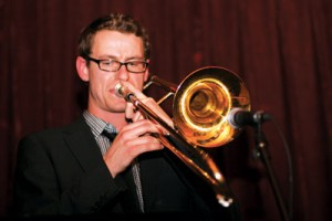 Photo by Kevin Rushworth. Here, Carsten Rubeling is rocking the trombone while performing with soul band Joanna and the Acrobatiks. He is also a professor in the two-year music performance diploma offered at Mount Royal University.