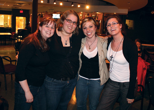 Photo by Bryce Visser. From left: Jennifer Langille, Megan Melnyk, Kaylene McTavish, and Michelle Dennis pose in the Liberty Lounge.