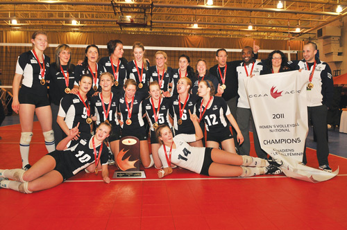 Photo courtesy of David Connell.  The Mount Royal University Cougars women's volleyball team celebrates its first-ever CCAA national volleyball championship March 12 in Saint John, New Brusnwick. The Cougars defeated Vancouver Island University three games to two in the title contest.