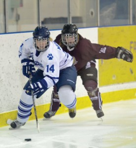 Chelsey Morrill battles with a MacEwan defender during the Cougars' 3-0 series sweep of the Griffins.