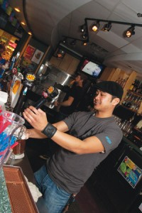 Photos by Bryan Weismiller.  Bartender Markus Tolentino pours a pint of Wild Rose WRaspberry Ale in the Liberty Lounge.