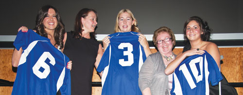 Photo by Blaine Meller. Above right, Chelsey Ruckdashel, Ashley Dixon and Meghan MacDonald receive their game jerseys from athletic director Karla Karch (second from left) and Jean Jarrell of the Cougars Booster Club (second from right) as part of the fifth year athlete awards.