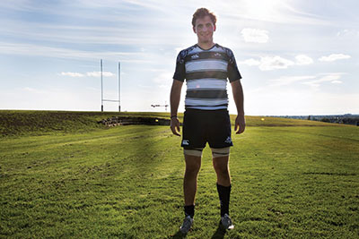 "The captain of the rugby team stands on the field after a game with U of A. Louden believes he was selected for the captain position because of his ""quiet leadership."" Photo: Claire Bourgeois"