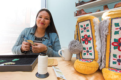 Rosary Spence, a Cree artist and designer, brings one-of-a-kind Aboriginal fashions to Calgary. Spence works with Manitobah Mukluks, a company that contracts artists from all across Canada to help keep Aboriginal traditions alive. Photo: Jesse Yardley
