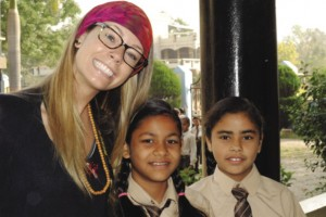 Ali Hardstaff posed with students from Sri Ram Ashram while taking part in the 2014 India Field School. Photo: Zana El-Youssef