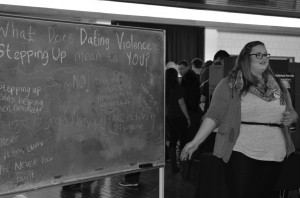 "Students stepped up to raise awareness about dating violence prevention during the Stepping Up Community Fair on March 16. Laurie Gaal (pictured above) asked students, ""What does dating violence and stepping up mean to you?""Photo : Dayla Brown"