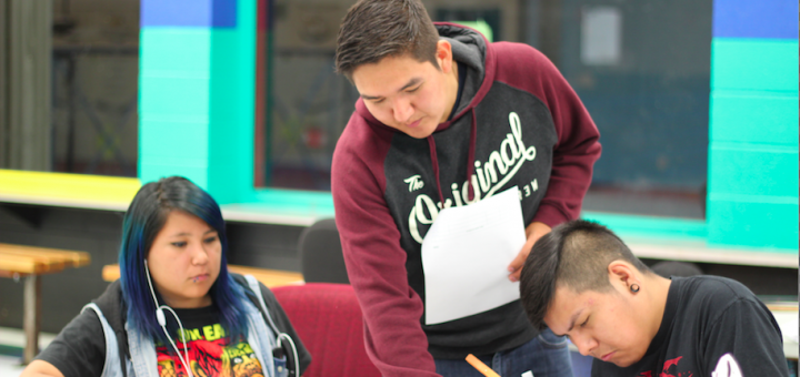 Solway helps two of his students at the film camp he created to help build a community of filmmakers in Siksika. Photo courtesy of Trevor Solway